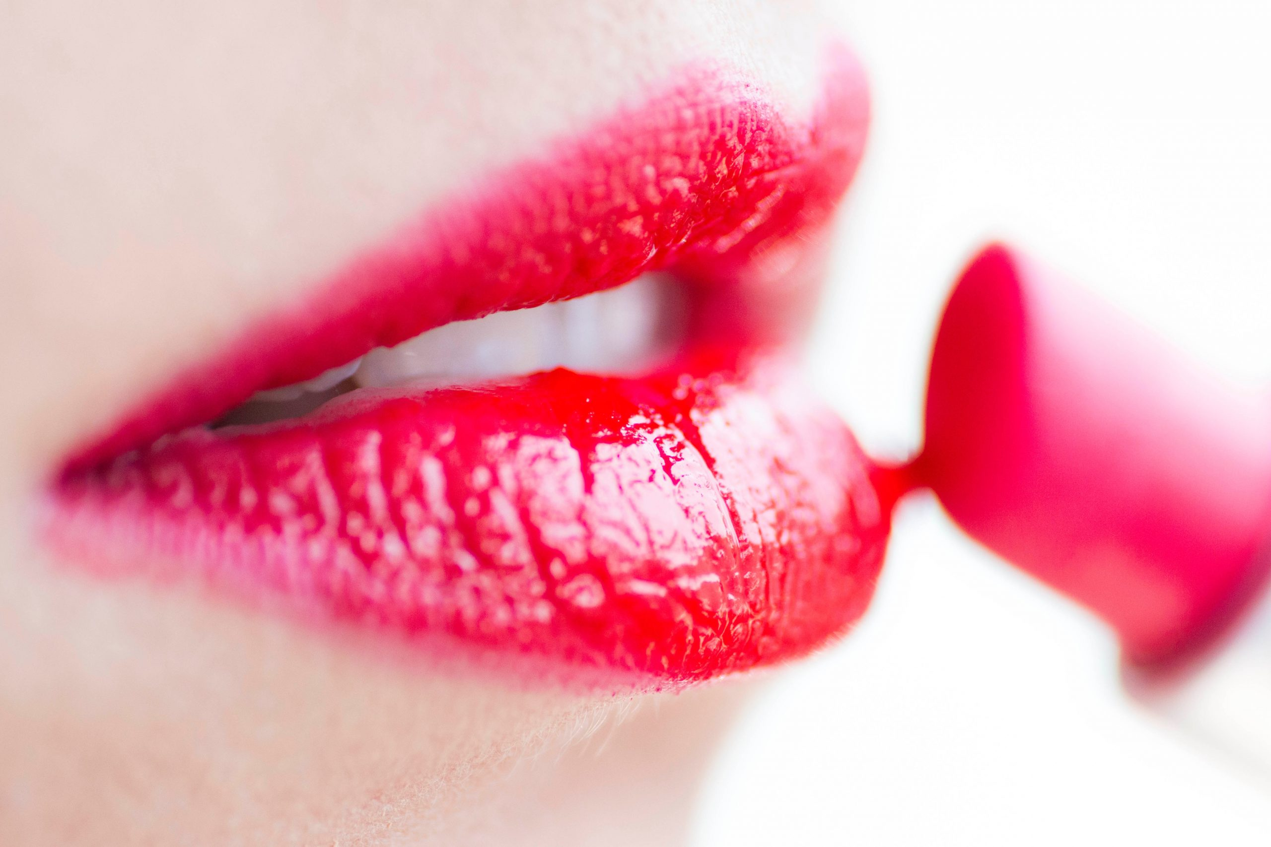 close-up of red Lips applying red lipstick